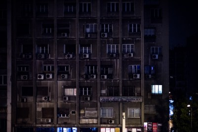 An apartment block seen from the window of a hotel room in central Athens. In this hotel, Syrian refugees freshly arrived in Greece have found shelter for the last months as they wait for their asylum papers to be authorized by the greek authorities.