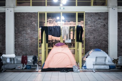 Tents and some clothes hanging inside a a passenger terminal temporary used as shelter for refugees and migrants in the port of Piraeus near Athens. The Balkan trail from Greece to northern Europe used by floods of migrants was blocked in early March 2016.