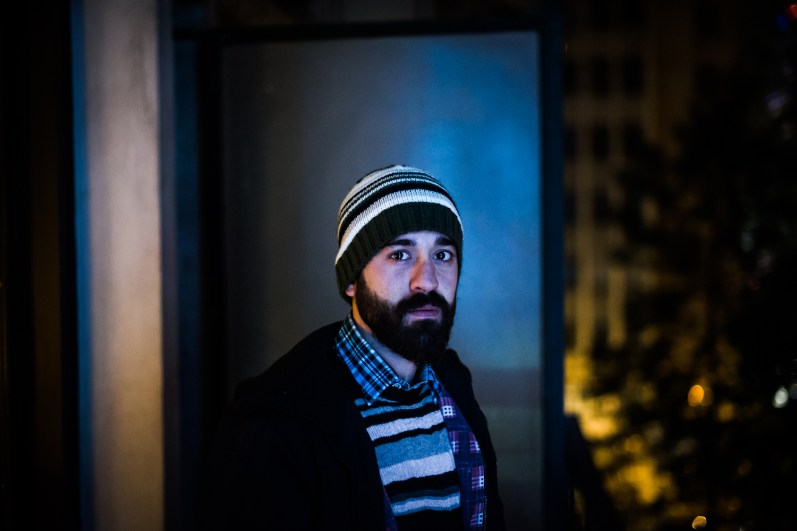 Abdala Omar Yahya, a refugee from Syria poses in the balcony of the hotel room where he currently lives in central Athens. Abdala fled Syria towards Turkey and in late December 2014 he crossed the Aegean Sea by boat to arrive in Greece in order to continue his journey to western Europe.