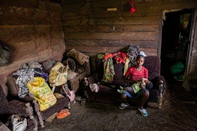Rose, 16 years old, is currently breastfeeding her first child of 5 months. The father of the baby never came to take his responsibilities, so Rose's father is the only one who is taking care of her and the baby, as Rose's mother already passed way. Bakumba, Cameroon. 2014
