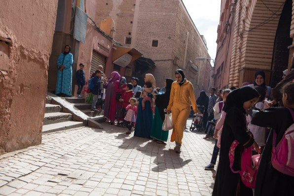 Some children coming back home from a school in Medina. Very often, women in Morocco walk in pairs or in groups, sharing together the various daily activities to be carried out in the city.