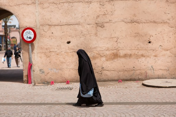 A woman covered by a burqa walks on a street in Marrakech. In Morocco, the population is predominantly Muslim (Sunni 97%, Sciiti 2%).