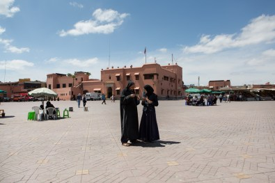 Jemaa el Fna. A man and a woman in a common meeting place of Marrakech, where every day several vendors sell goods of all kinds.