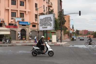 On the streets of Marrakech, a young woman on a scooter. The possibility for women to drive a private vehicle it's not allowed in all Islamic countries.