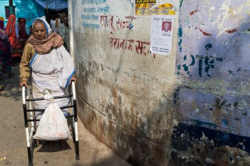 Besaki Dasi (75) on the way from her Ashram to beg in the streets. She came to Vrindavan 35 years ago.