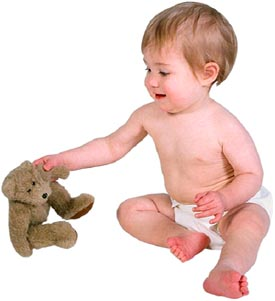 Baby separation anxiety: little baby boy with a teddy bear or a lovey