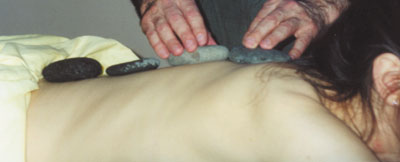 Heated healing stones are placed along the spine before the massage. The warmth of the stones penetrates the major nervous system junctions and creates a deep, relaxing effect