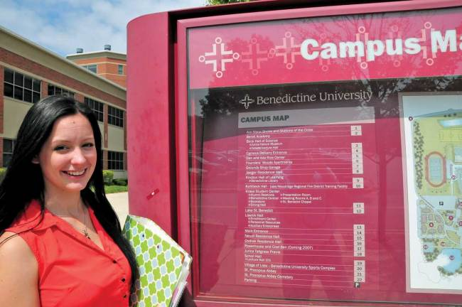 Kelly_at_Benedictine_sign