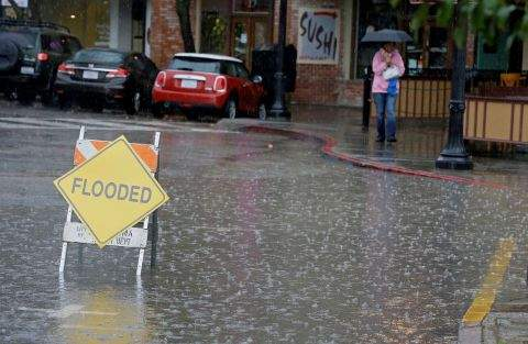Flooding In Front of McNears (AP Photo By Eric Risberg)