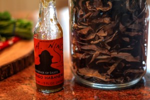 Two of Laurie Figoness favorites local habanero sauce and wild mushrooms