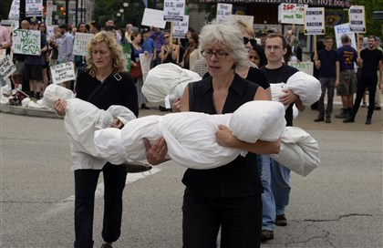 Rallying in suppport of Palestinians in Gaza Rallying in suppport of Palestinians in Gaza, protestors including Tavia LaFollette of Shadyside, left, and Susanne Slavick of Ross Township, right, cradling sheets wrapped to look like dead children