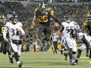 Steelers Le'Veon Bell leaps into the end zone for a touchdown against the Ravens on Christmas Day 2016.