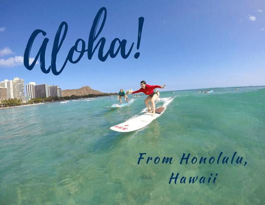 Front of postcard: Nicole surfing at Waikiki Beach