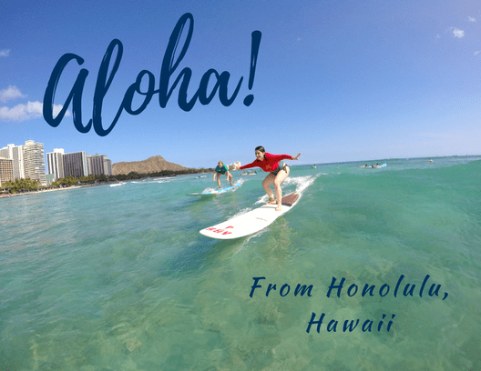 Front of postcard: Nicole surfing at Waikiki Beach