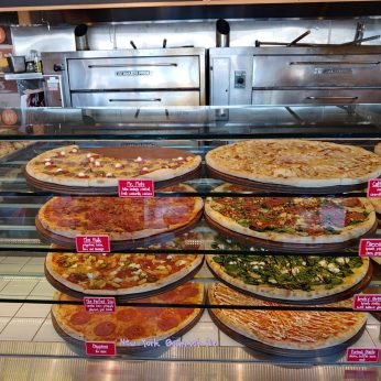 pizzas on display