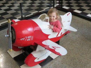 child in mini airplane