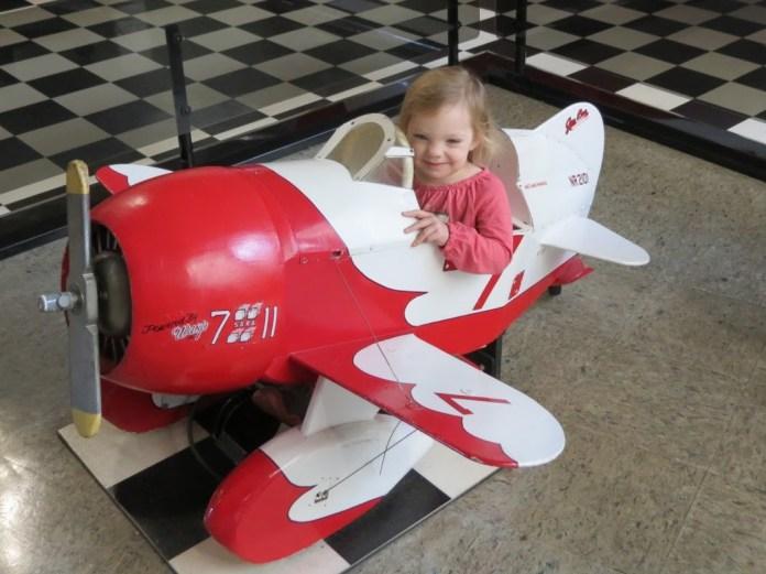 child in mini airplane