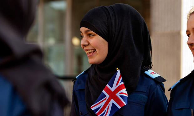 A Muslim girl watches an army parade in west London.