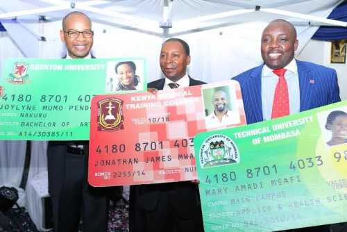 KCB Group CEO Joshua Oigara (left), Isaac Kamande (centre) the Chief Economist at the Ministry of Education Science and Technology and Mr. Charles Ringera, the CEO Higher Educations Loans Board unveils the KCB Helb Student prepaid smart card that will help students access funds for tuition, accommodation and subsistence.