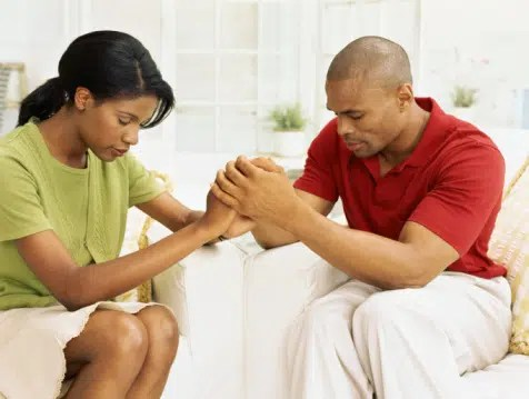 Husband and Wife praying together. Photo from http://blackfamilies.org/wordpress_1071086928/
