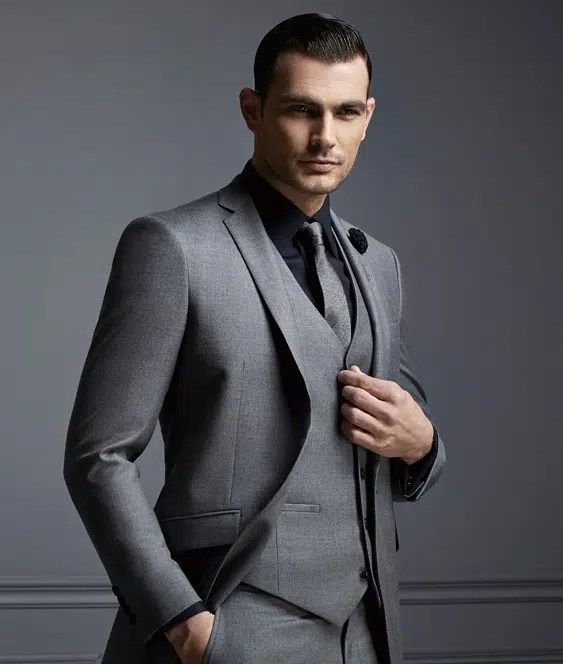 Man well dressed in a suit. Image from http://www.aliexpress.com/item/Top-Selling-New-White-Jacket-With-Black-Satin-Lapel-Groom-Tuxedos-Groomsmen-Best-Man-Suit-Men/32353627868.html