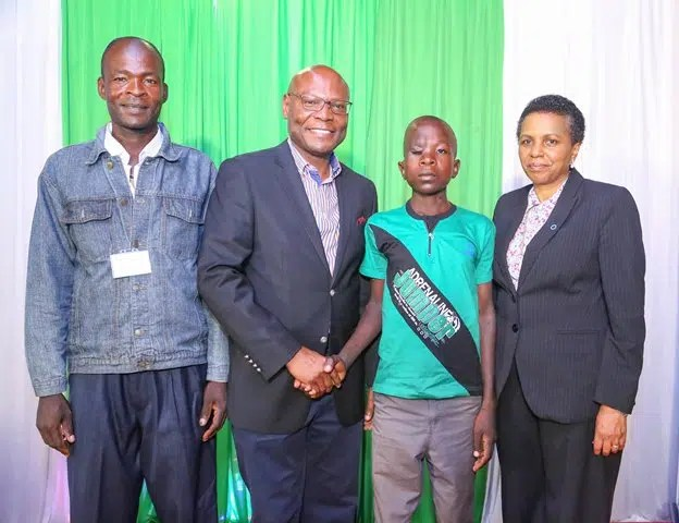 Safaricom Foundation Chairman, Joseph Ogutu (second left) and DMI Centre- Executive Director, Eva Muchemi (right) with Evans Wanjala, a 15-year-old eye surgery beneficiary and his father, Kenneth Wabwire. Photo Credit - Safaricom