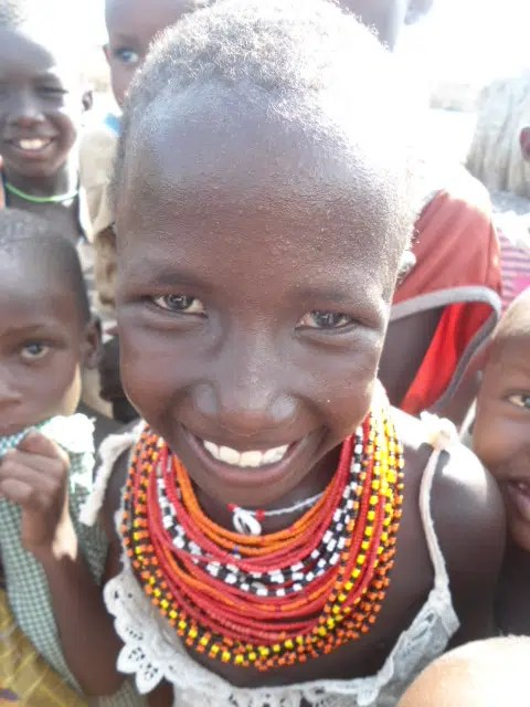 Naku a young girl from the small El Molo tribe. The El Molo live on the shores of L. Turkana in Loyiangalani