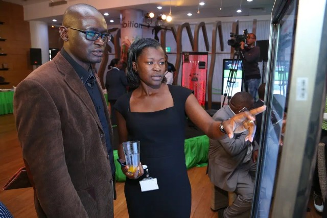 Safaricom SME Manager for Nairobi East Maureen Anyim assists Stephen Hongo of Copia Kenya fill in a Ready Business survey during the Safaricom Ready Business SME Symposium held at the Michael Joseph Centre. Image courtesy of Safaricom