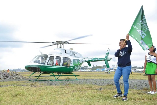 Safaricom Director Consumer Business Unit Sylvia Mulinge flags off one of the helicopters at Wilson Airport during the launch of the expanded Safaricom's 4G Network across major towns and regions in the country. The move will see more Safaricom customers enjoy faster Internet speeds as well as greater connectivity. Some customers had a chance to go on a helicopter ride. Picture courtesy of Safaricom.