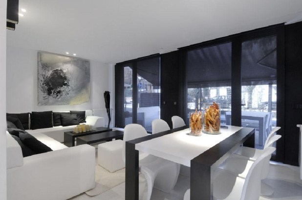 Modular-House-in-Madrid-Spain-interior-design-dining-and-living-room 25 Elegant Black And White Dining Room Designs