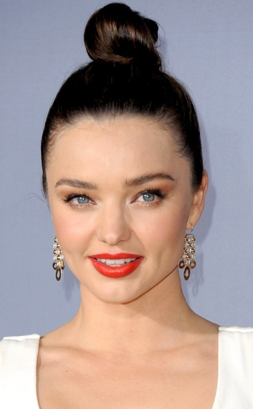 Miranda Kerr - Messy and Sleek High Bun Hairstyle