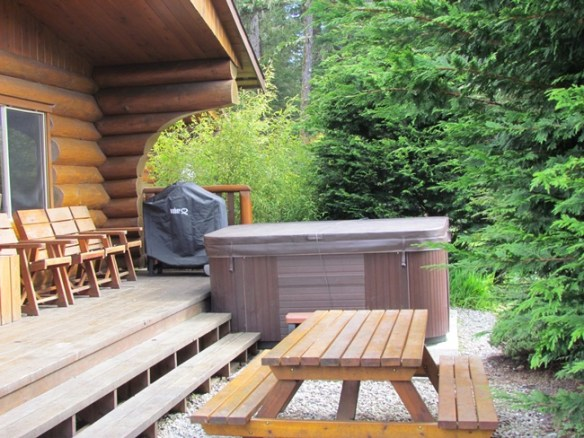 Our deck with hot tub, great to enjoy the view