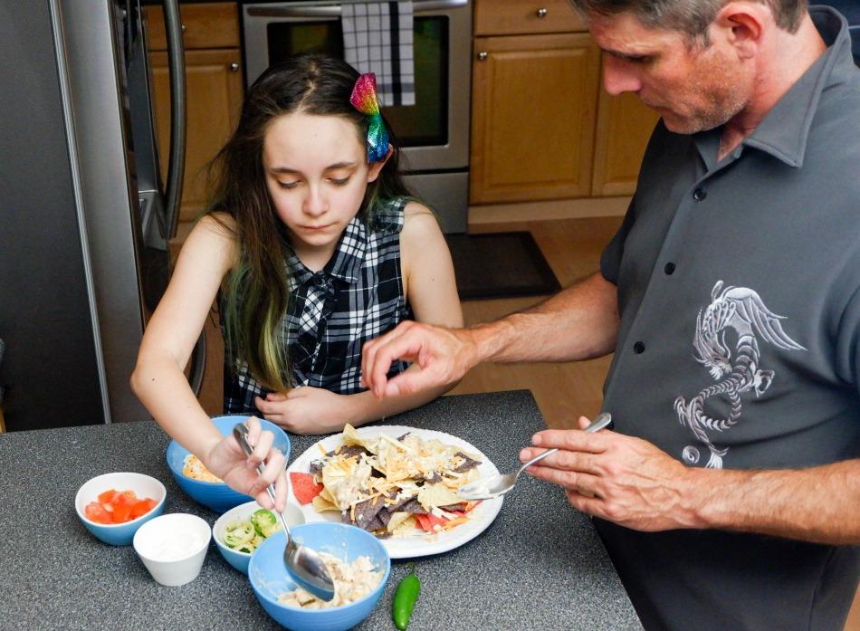 family making nachos