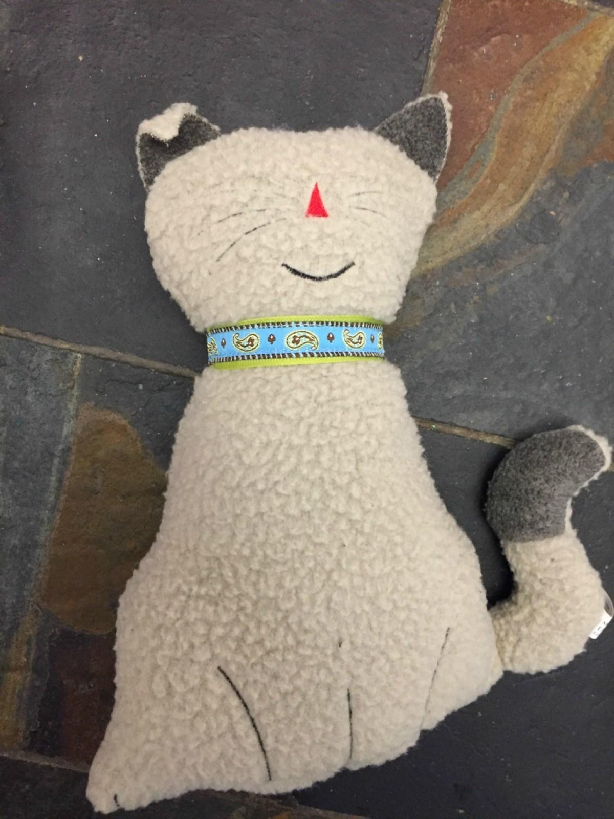 sitting cuddle cat, dog toy