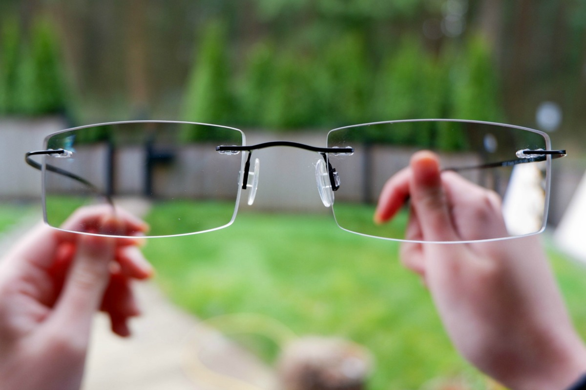 Clearly Rimless Frames outside with transition lenses