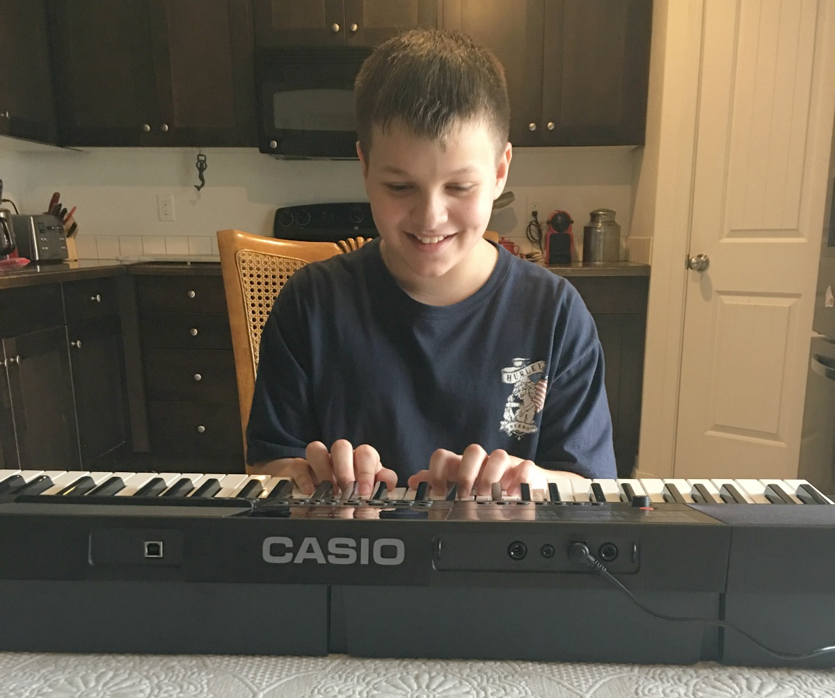 The Benefits of Teaching Kids How to Play a Musical Instrument - Powered by Mom