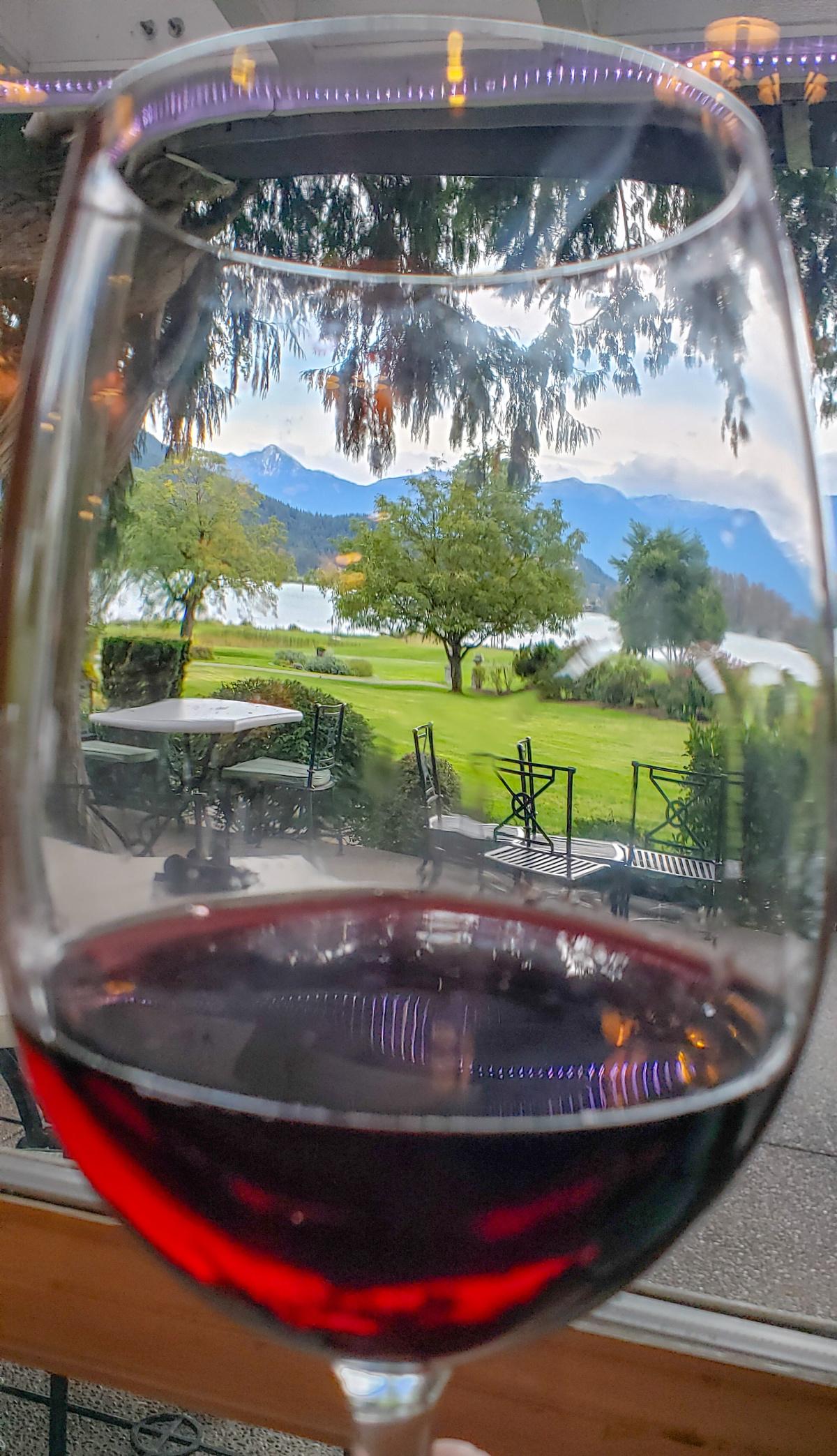 River's Edge golf course view through a wine glass