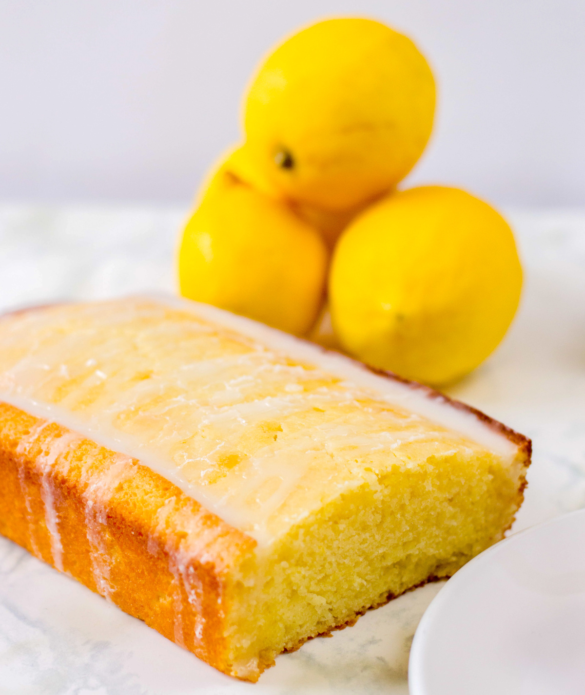 lemon loaf with lemons in the background