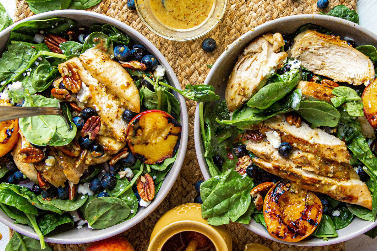 grilled peach salad with grilled chicken two bowls