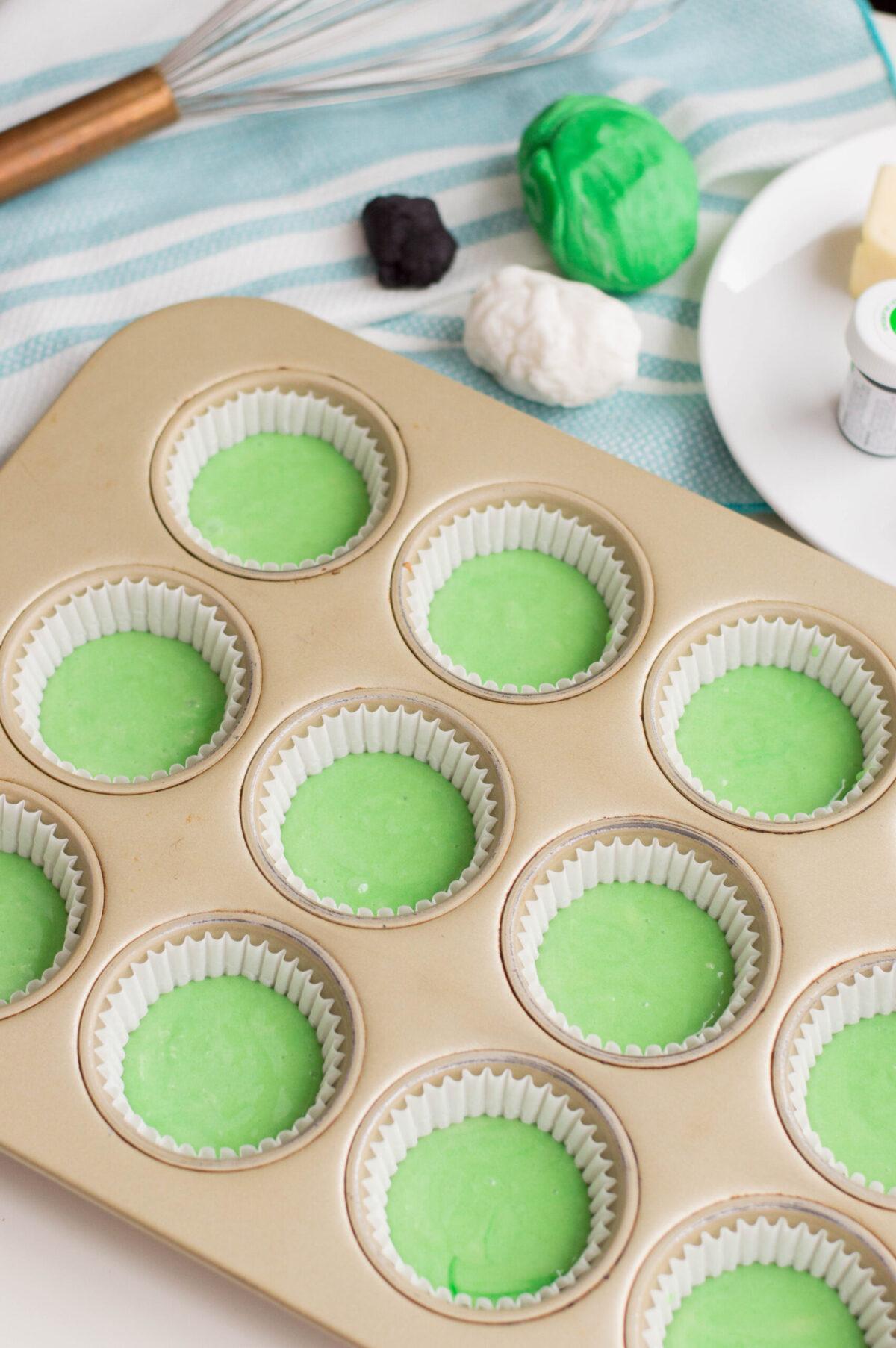 muffin tin with cupcake mix