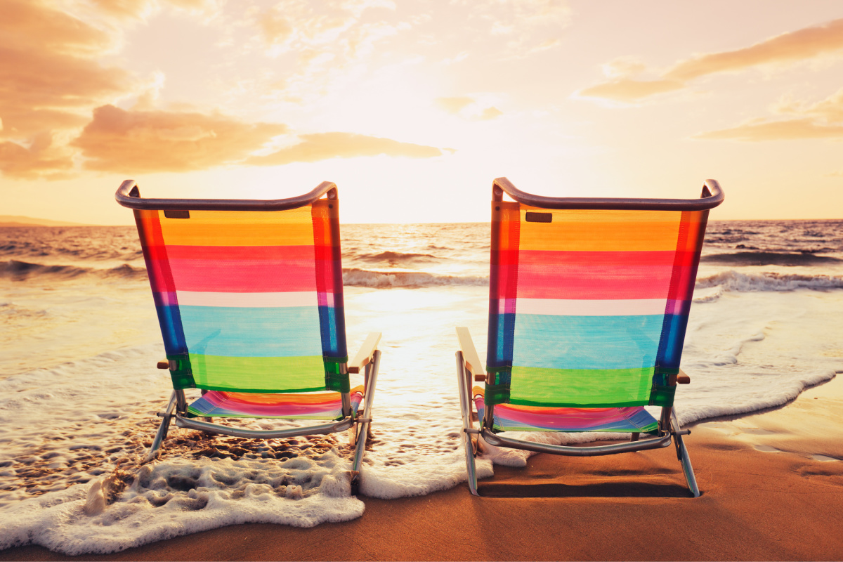 summer scene, beach chairs with waves on sand