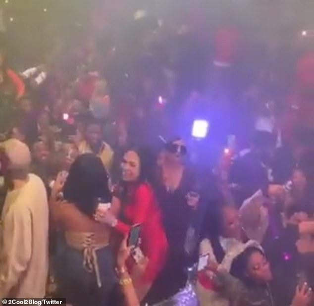 Risking it all: The rapper had the club jumping as many seemed keen to get out of the house at all costs