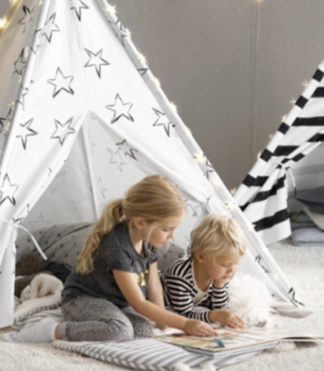 Read children's books in a teepee