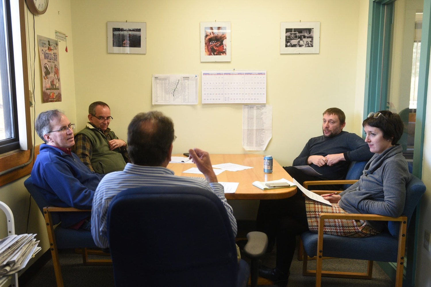 Valley News Web Editor Maggie Cassidy, right, participates in the weekly planning meeting at the Valley News in West Lebanon, N.H., on Dec. 4, 2018. From left are Photo Editor Geoff Hansen, News Editor John Gregg, Editor Martin Frank and Features Editor Alex Hanson. Cassidy has been named the newspaper's next Editor, starting the job on Dec. 17. (Valley News - Jennifer Hauck) Copyright Valley News. May not be reprinted or used online without permission. Send requests to permission@vnews.com.