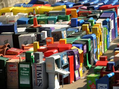 Discarded newspaper racks clutter a storage yard in San Francisco in 2009. (AP Photo/Noah Berger, File)