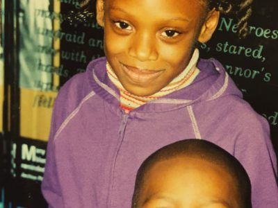 The author, Brandi Griffin, and her little brother visit The King Center in Atlanta as children. Griffin writes that growing up on the west side of Atlanta had no bearing on her home life or academic success, and that the narrative about communities of color has been dictated by those who know nothing about them.