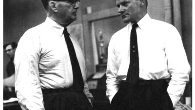 Ralph McGill and Gene Patterson in the newsroom of the Atlantic Constitution, circa 1965. Both men wrote daily columns in support of racial justice, and both received threats because of their stands.