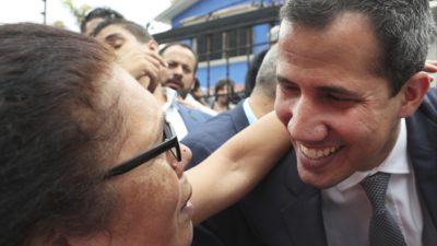 Opposition leader Juan Guaidó greets a supporter as he leaves a press conference in Caracas, Venezuela, on May 3, 2019. In the fourth month of their standoff, President Nicolás Maduro and Guaidó are unable to deliver a knock-out blow as Venezuela spirals deeper into neglect, isolation and desperation. (AP Photo/Martin Mejia)