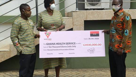 Abena Adubea Amoah (Executive Director) & Gideon Leckson-Leckey (PPAG National Treasurer) presenting the cheque to Dr. Patrick Aboagye, Director General, Ghana Health Service