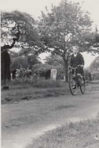 old photo of Grace Jolliffe cycling illustrating article about writing the novel, Piggy Monk Square